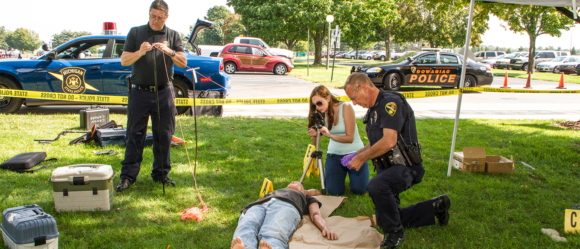 Criminal justice student learning crime scene investigation from state police