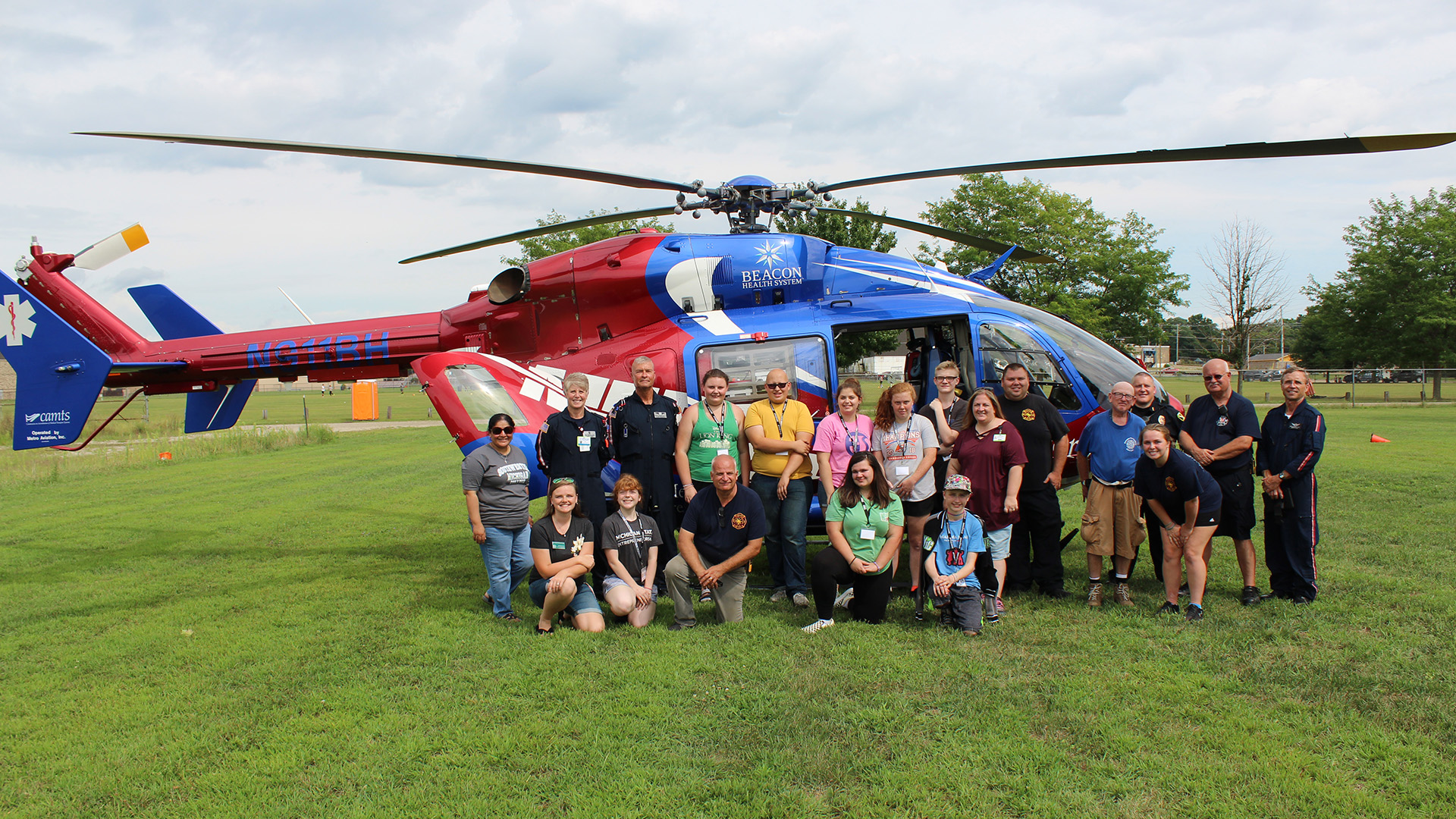 Students in front of a helicopter
