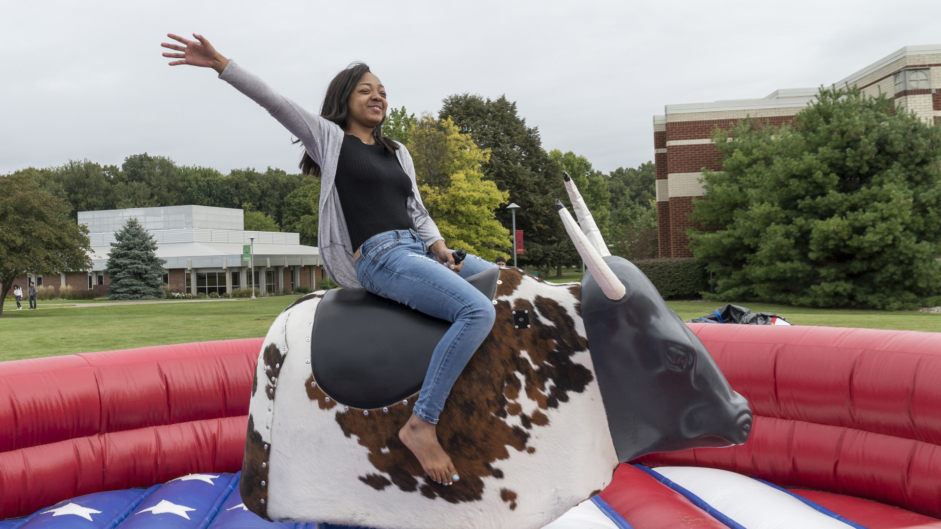 Student riding a mechanical bull during campus bash